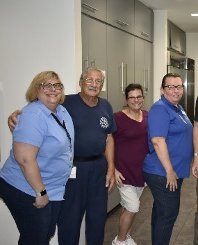 Virginia Smith with other food prep staff