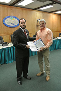 Mr. Bo Trivett accepting certification from Vice-Mayor DeLorenzo on October 7, 2014