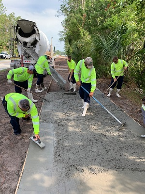 Sidewalk installation on Sesame Blvd
